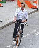 Simon Baker rode a bike around Paris on Monday while filming a Givenchy commercial.