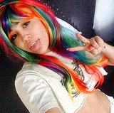 She Tries on Rainbow Wigs . . . and Takes Another Selfie.