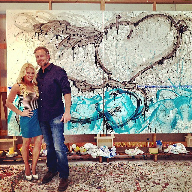 Eric and Jessica posed together in front of their new art piece on their four-year anniversary in May 2014. Source: Instagram user jessicasimpson
