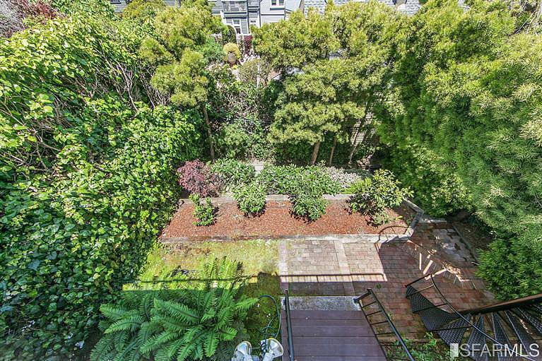 Lush trees and a garden make this city home feel extraspecial.  Source: Coldwell Banker