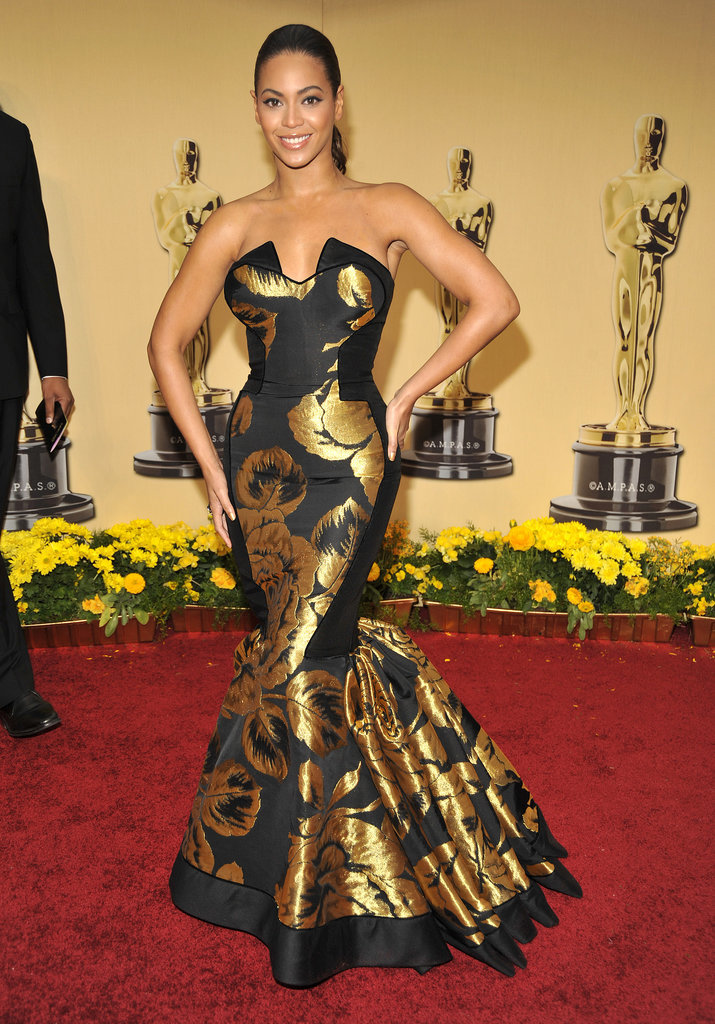 Beyoncé looked stunning in a gilded House of Dereon (her mother's label) fishtail dress. Major points awarded for glamour, but we bet it wasn't the most comfortable of gowns!