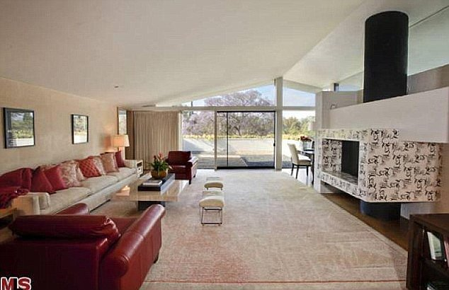 The family room complete with a unique fireplace.  Source: MLS