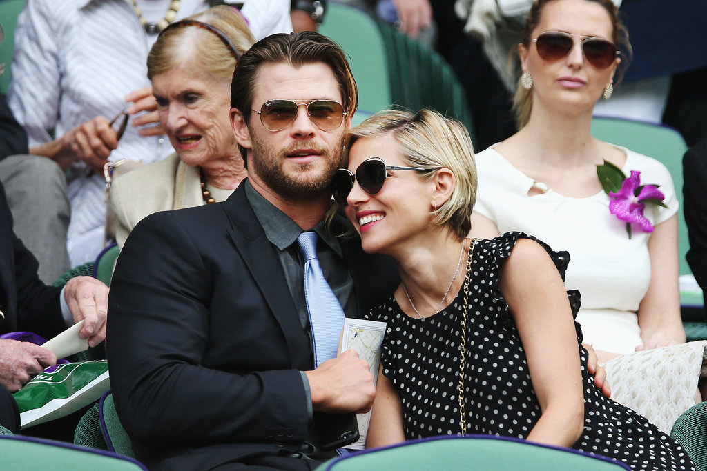 Chris Hemsworth and Elsa Pataky cozied up at the Wimbledon men's final match on Sunday in London.