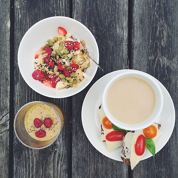 A breakfast that has us envious: mango and nectarine smoothie, oats with peanut butter and berries, and danish rye bread with cheese and tomato. Let's not forget the caffeine boost, either! Source: Instagram user iclfood