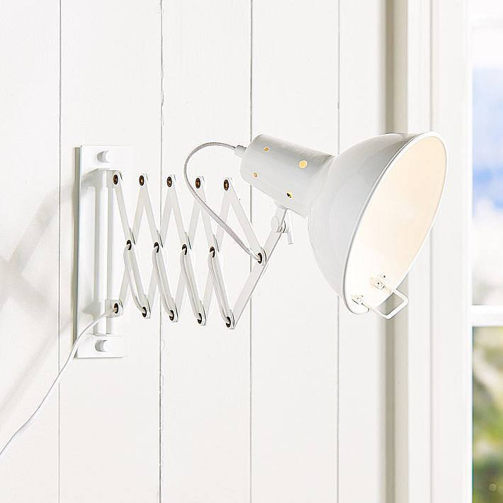 The white color adds a fresh look to this Accordian Wall Light ($179).