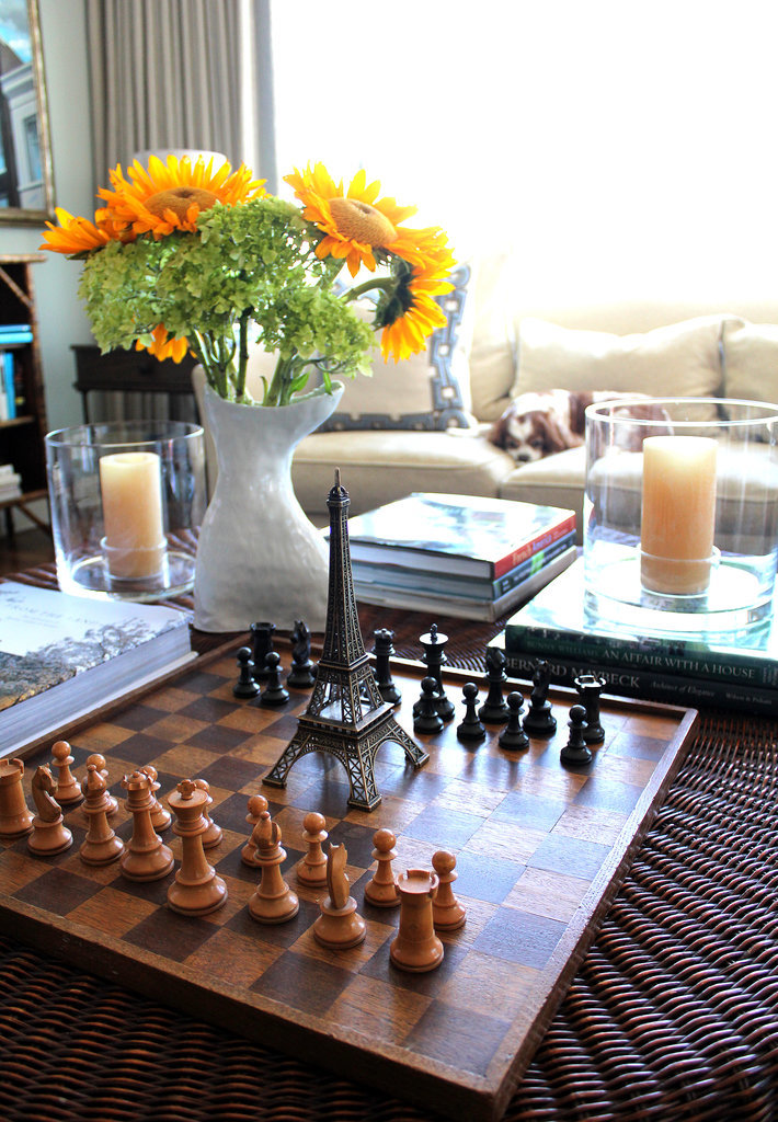 Now here's proof that a good coffee table is all about layering and getting guests talking. Who wouldn't want to sit down in front of sunflowers, a classic chess board (from a flea market in Amsterdam), and an Eiffel Tower statue?