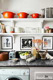 Now this is a small kitchen done right! Open shelves — a 2014 design trend — keep the kitchen from feeling small and enclosed (something you risk with cabinets). But it's details like bright cookware and framed art that add a personal touch. Even better, there's space for a washer . . . crucial.  Source: Amy Neunsinger via House Beautiful