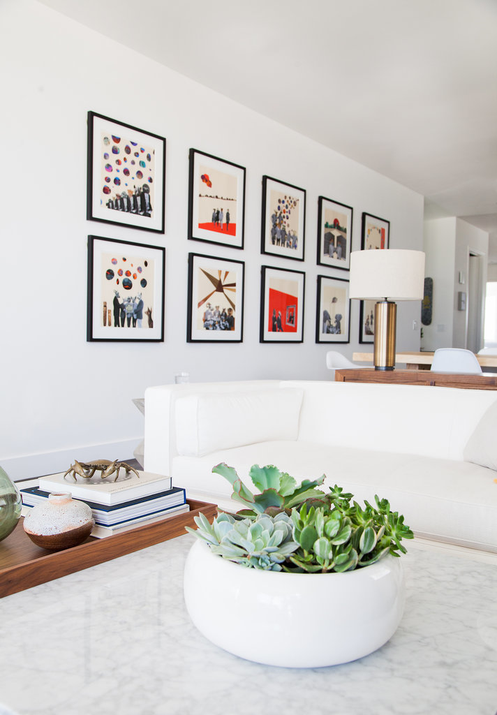 With white walls as the foundation, the owner's art collection truly pops.  Photo by Tessa Neustadt via Homepolish