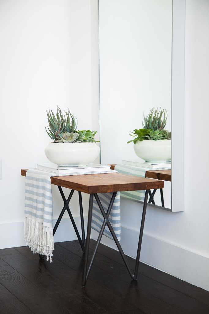 Inviting details like a throw and carefully styled succulents act as the finishing touches.  Photo by Tessa Neustadt via Homepolish