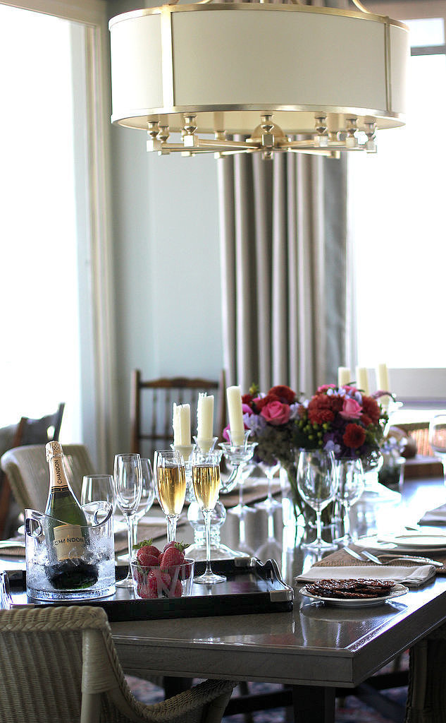 Head over to the dining table, and you get a warm Southern vibe.  The recipe? Glamorous overhead lighting, a gorgeous centerpiece, and Champagne. Always Champagne.
