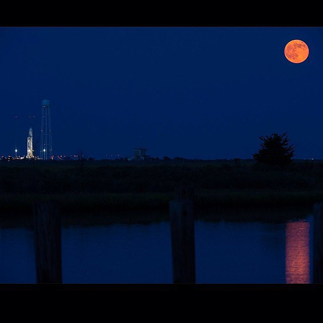 """A full moon is seen rising over Orbital Sciences' Antares rocket ready to carry #Orb2 to the #ISS,"" according to NASA's Instagram. Source: Instagram user NASA"
