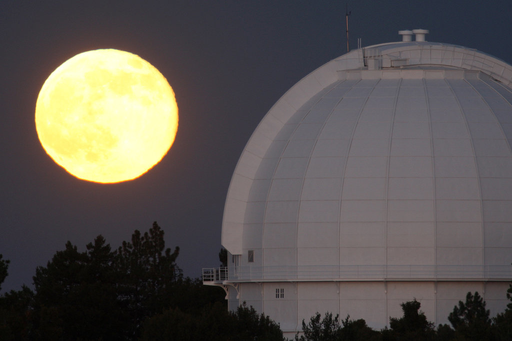 The supermoon sizes itself up next to the Mount Wilson Observatory in Los Angeles.