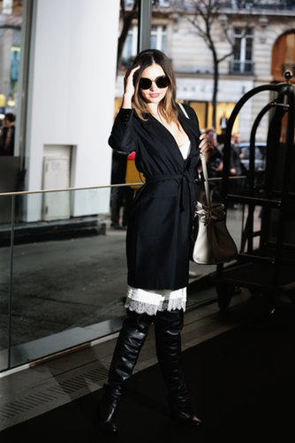 During Paris Fashion Week, Miranda left the Sonia Rykiel runway show in a black trench and over-the-knee boots. A peek of white lace on the hem of her dress is very Parisian chic, no?