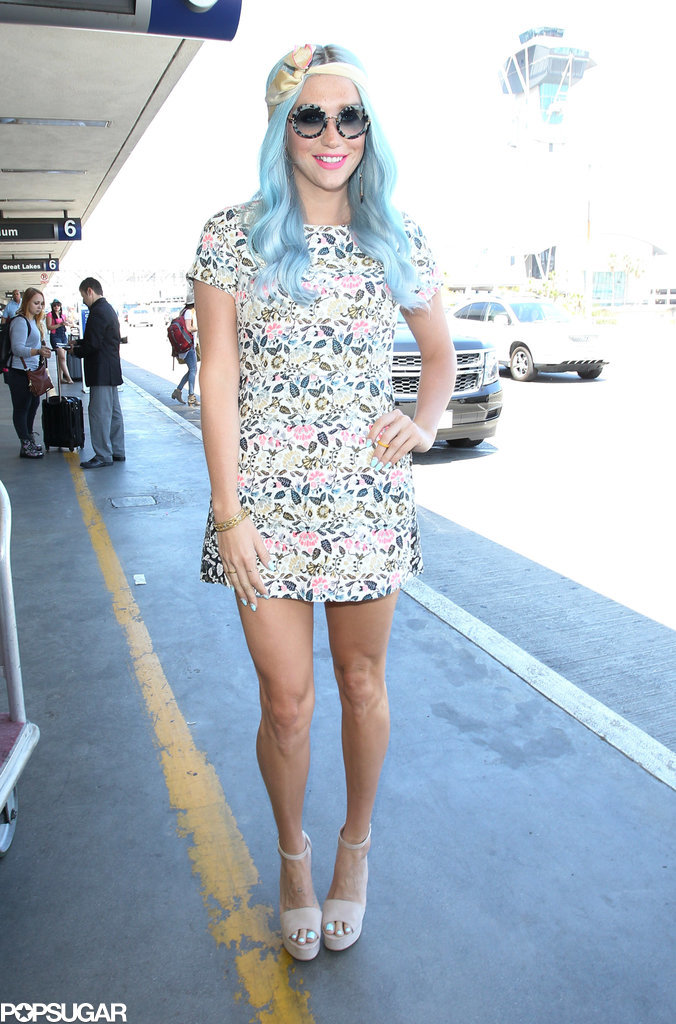 Kesha showed off her new blue hair at LAX on Tuesday.
