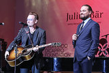 Leonardo DiCaprio smiled at his foundation's gala in Saint-Tropez, France, on Wednesday while on stage with Bono.