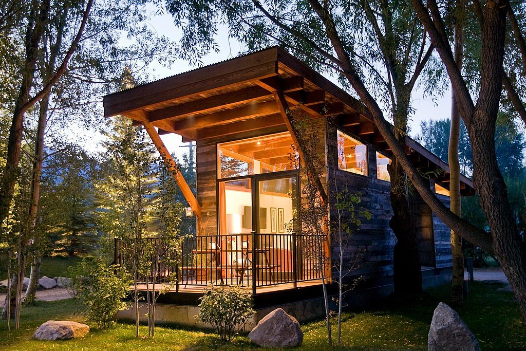 "Aptly named ""The Wedge,"" this chic cabin features large windows to create the appearance of open space. Wheelhaus also builds all their tiny homes on wheels, allowing buyers the option of mobility with their small dwellings. Because of this fun feature, The Wedge's large windows can take in views of relaxing beaches and lush forests, not limited to one or the other."