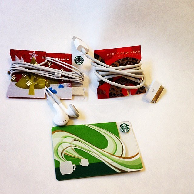 Keep cords tidy by wrapping them around old gift cards.