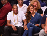 """Source: Getty / James Devaney May 12: Despite all the hoopla about the elevator fight (including speculation as to what caused the attack), Beyoncé and Jay Z appeared completely unfazed as they sat courtside for a Brooklyn Nets game. Reports surfaced that Beyoncé got her wedding tattoo, the Roman numerals """"IV,"""" removed from her ring finger.  May 14: Without saying a word, Beyoncé gave a subtle response to all the drama by sharing a series of sweet throwback photos of her and Solange on Instagram. May 15: Jay Z and Beyoncé finally addressed the incident in a joint statement given to the Associated Press and let the public know that they've moved on: """"At the end of the day families have problems and we're no different. We love each other and above all we are family. We've put this behind us and hope everyone else will do the same."""""""