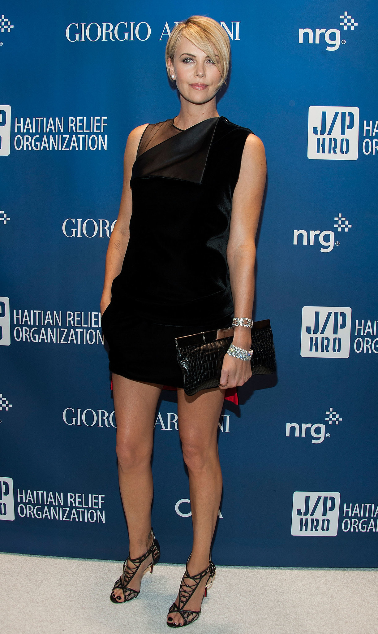 The geometric details of Charlize's look make for an eye-catching outfit with multiple focal points.