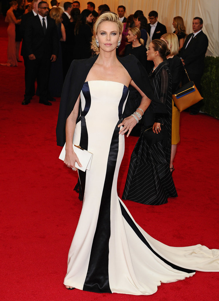At the Met Gala, Charlize wore Dior Couture, choosing the same elegant silhouette that always seems to suit her. A draped tuxedo jacket adds some structure to her look.