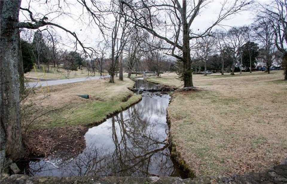 This lovely creek that runs through the property is just one of its many charms.  Source: Zillow