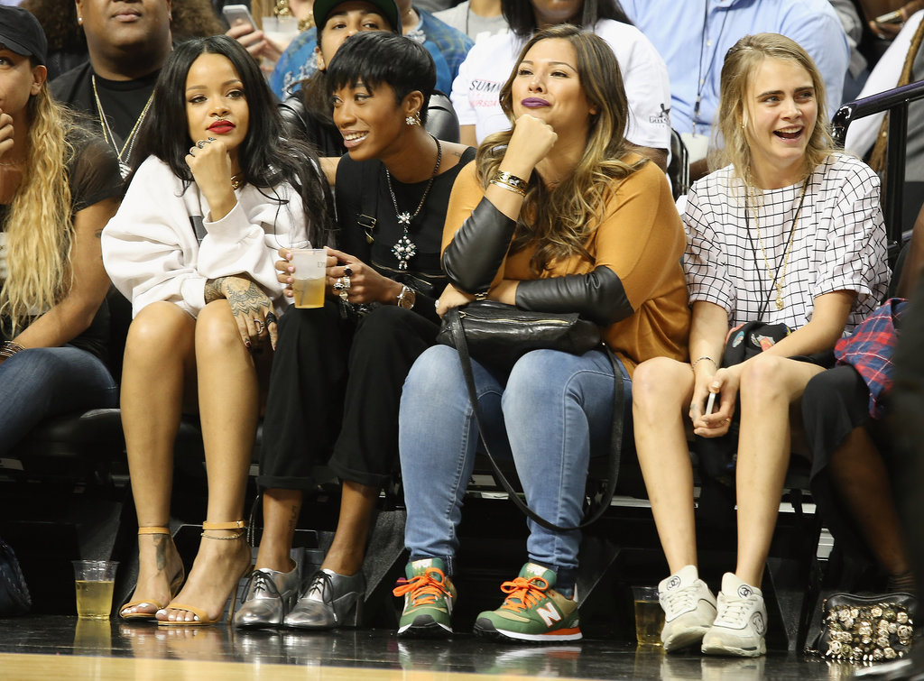 Rihanna sat with a group of girlfriends, including Cara Delevingne.