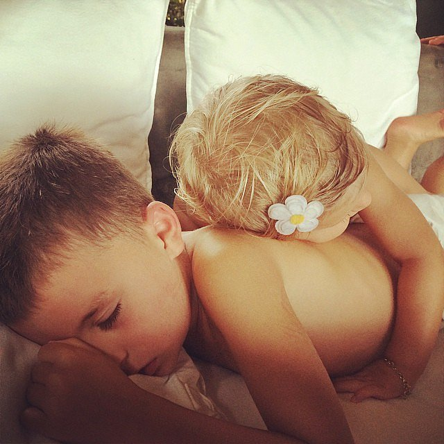 Benjamin and Vivian Brady shared a hug (and a nap) under Gisele's watchful eye.
