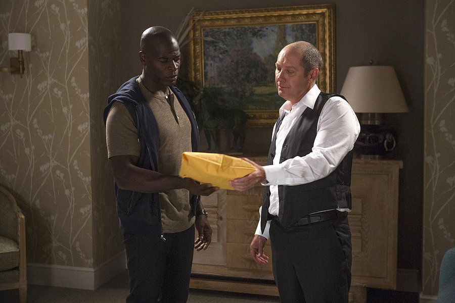 Dembe (Hisham Tawfiq) gives Red a package.