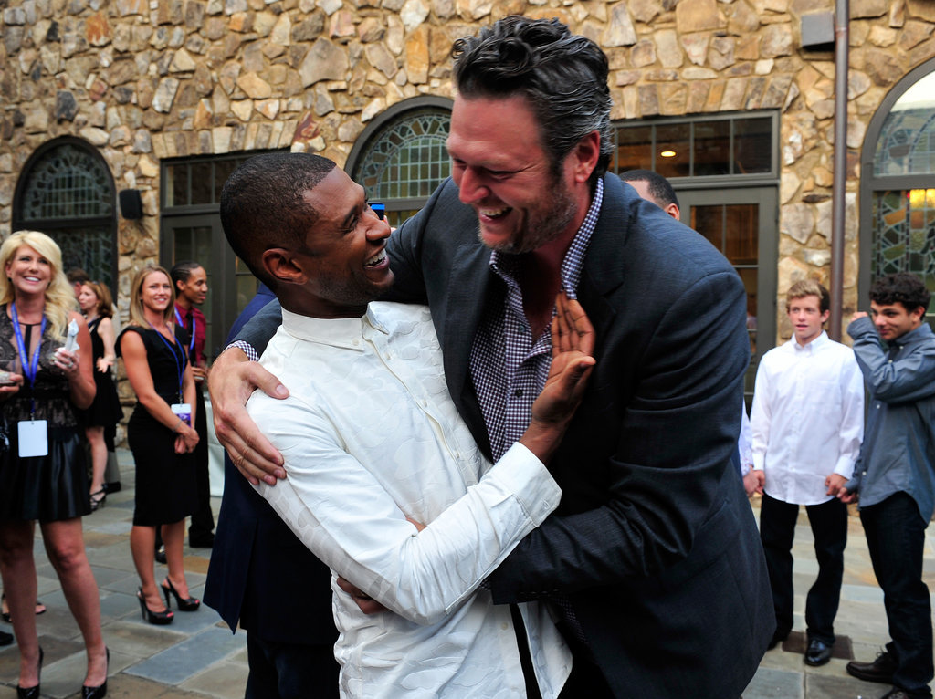 Usher shared a cute bro-ment with his fellow Voice coach Blake Shelton at a fundraiser for his charity in July 2014.