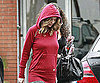Slide Photo of Ellen Pompeo Walking in Red Hoodie in the Rain