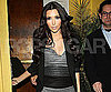 Slide Photo of Kim Kardashian Wearing Striped Dress Leaving Restaurant
