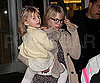 Slide Photo of Michelle Williams Carrying Matilda Ledger Through the Airport
