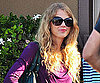 Slide Photo of Taylor Swift Wearing a Purple Shirt in LA