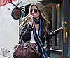 Slide Photo of Gisele Bundchen Covering Baby Bump in NYC