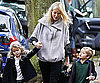 Slide Photo of Gwyneth Paltrow Picking Up Apple and Moses From School