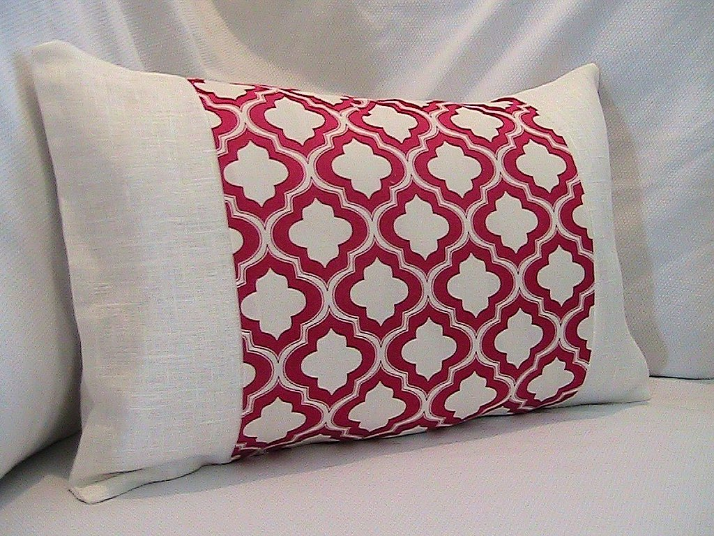 The 12-x-18-inch Cherry Trellis Lantern Lumbar Pillow ($25) from Nena Von is fun and preppy.