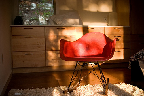 Soften an Eames rocker by placing a flokati rug beneath it.  Source:  Flickr User Jake Liefer