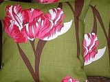 These Two 16-inch Green and Pink Flower Pillow Cases ($20) are playfully traditional.