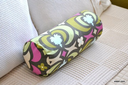 This cheerful 14-x-6-inch Bolster Cover ($20) is made of Amy Butler Nigella Water Lotus fabric.