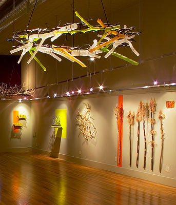 Artist Denise Snyder sculpted glass into these brightly colored branch chandeliers.