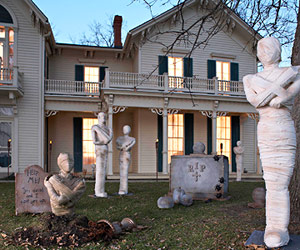 Create a spine-chilling scene by making mummies for your lawn.
