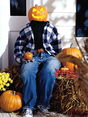 Greet trick-or-treaters with a pumpkin head man.