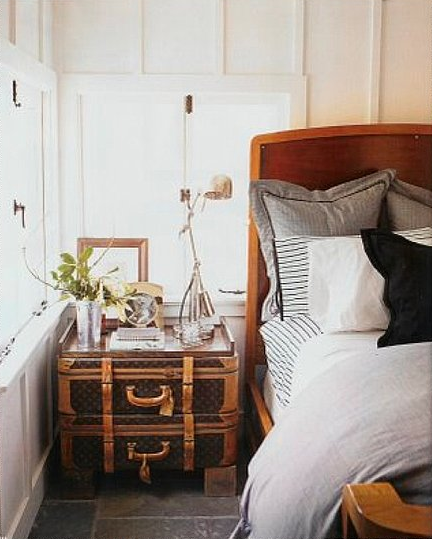 Use a tray to top stacked suitcases and display bedside objects. If you need extra height, a few bricks can help. Source