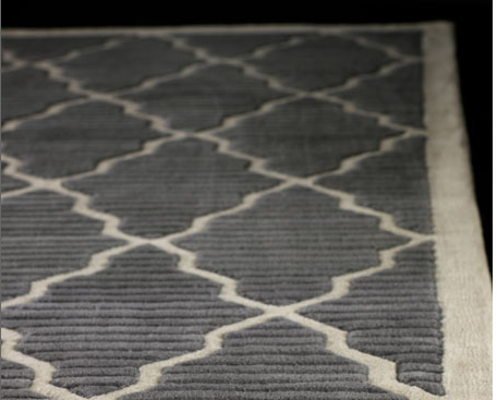 The Pemberton Rug ($629) features a sophisticated gray-and-ivory color palette and a contemporary trellis design. It's made of tufted wool with a canvas backing.