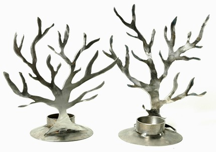 Made of recycled steel, these Votive Trees ($40) have industrial flair, but will create beautiful shadows around your room.