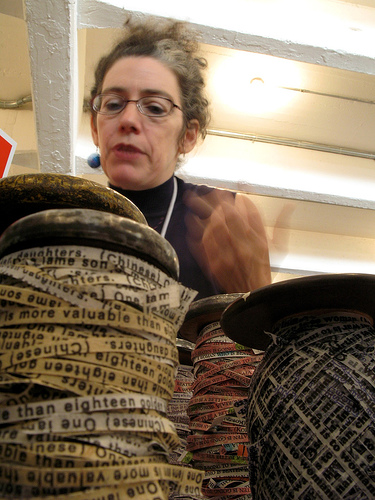 Artist Robbin Silverberg spins ribbon cut from books spun onto antique spools. Source: Flickr User cactusbones