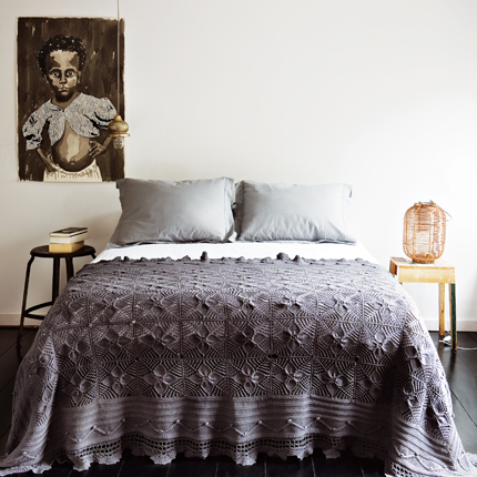 If you read my little intro to cool colors, you know that gray is a great color for the bedroom because it is calm and relaxing. This crocheted gray coverlet has violet undertones that make it a touch romantic, while still sober and not too feminine. It's a great hue for gender-neutral bedrooms. Source