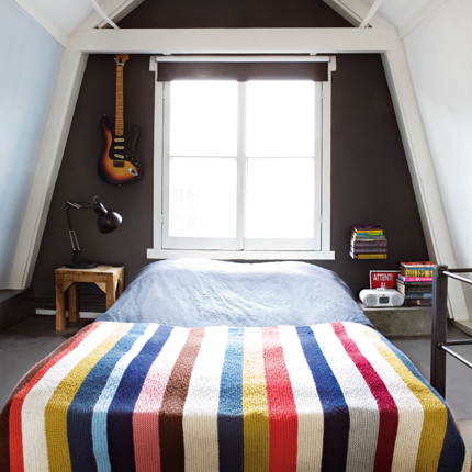 If you're opting for some very colorful elements and powerful patterns, you can use gray to tone down their vivacity. But try to use them in the same line of sight. For instance, an accent wall painted gray opposite this striped bedspread wouldn't do as much for it as the one behind it. Source