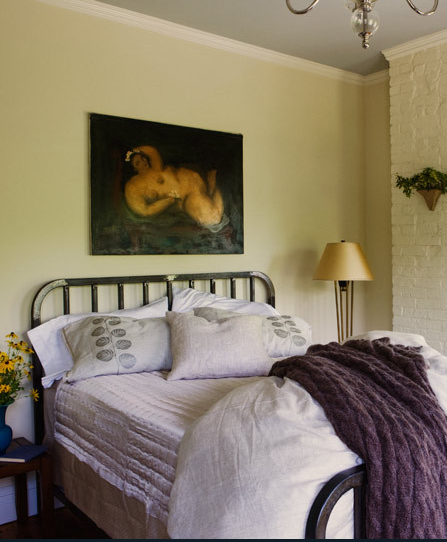 For more energy in your space, use colors that contrast each other. The warm yellow-green wall tone is a nice contrast to the lavender and purple bedding, and definitely ups the energy level in this room, while still maintaining a calm presence overall.  Source