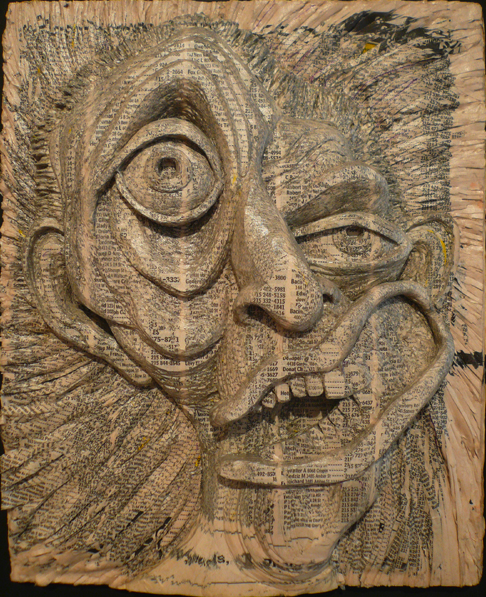 Artist Alex Queral carves faces out of phone books, sealing them with acrylic.